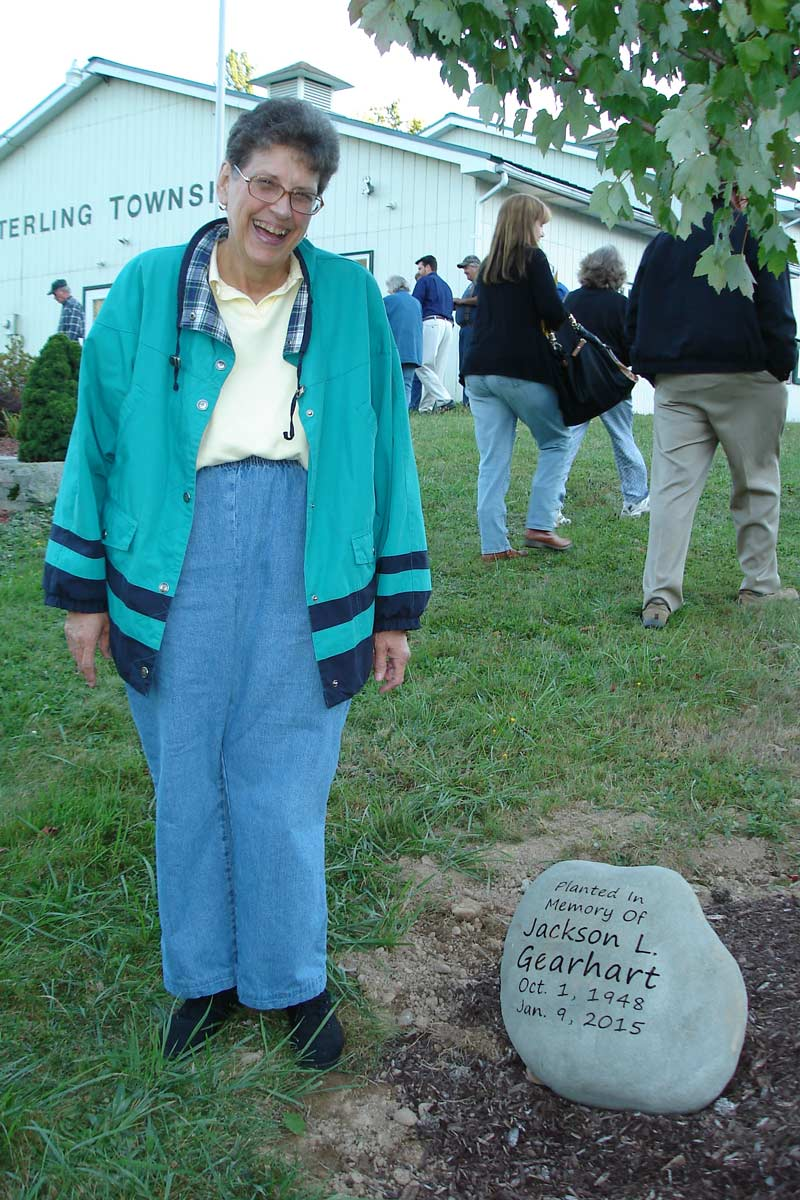 Linda Gearhart with a memorial plaque for her brother, Jack.